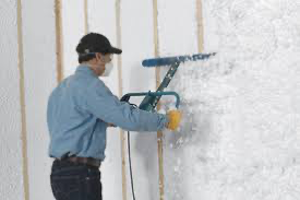 worker blowing in insulation 4